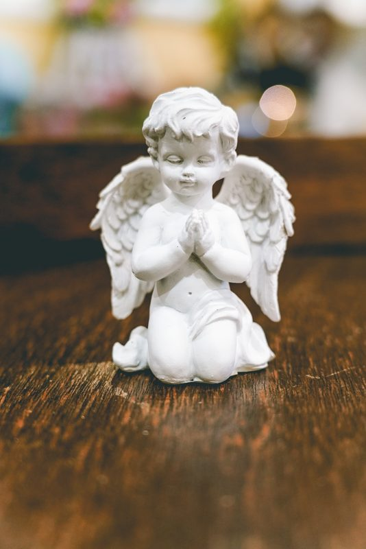 Angel boy praying